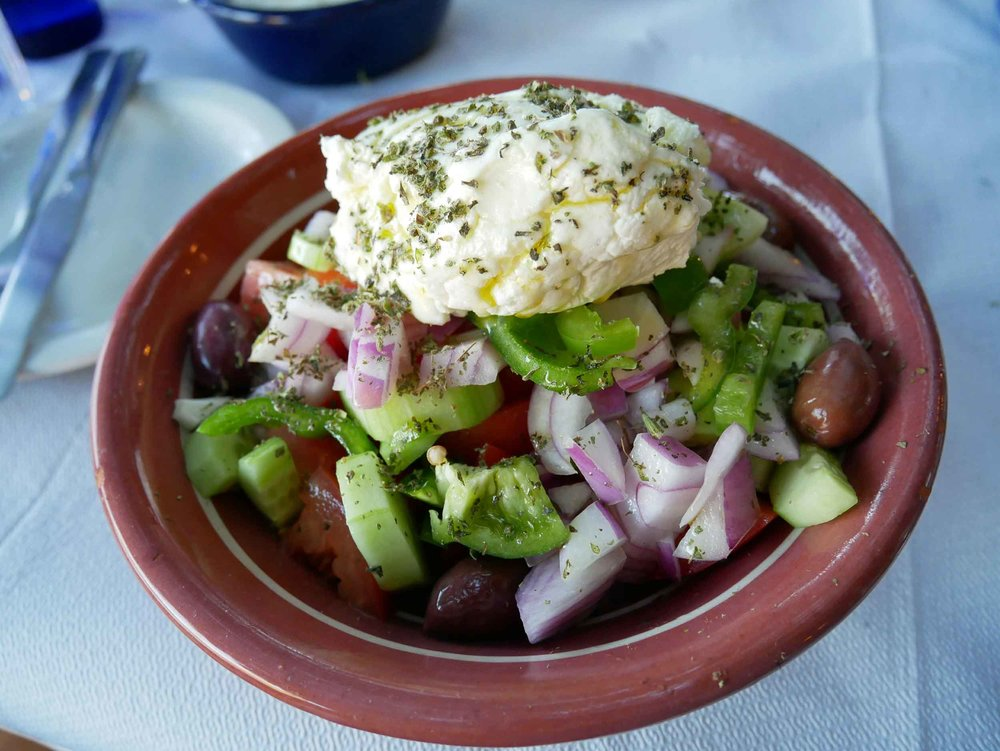 Greek salad with a local Sifnos cheese which is made from goat or sheep milk - a delicious local take on feta!