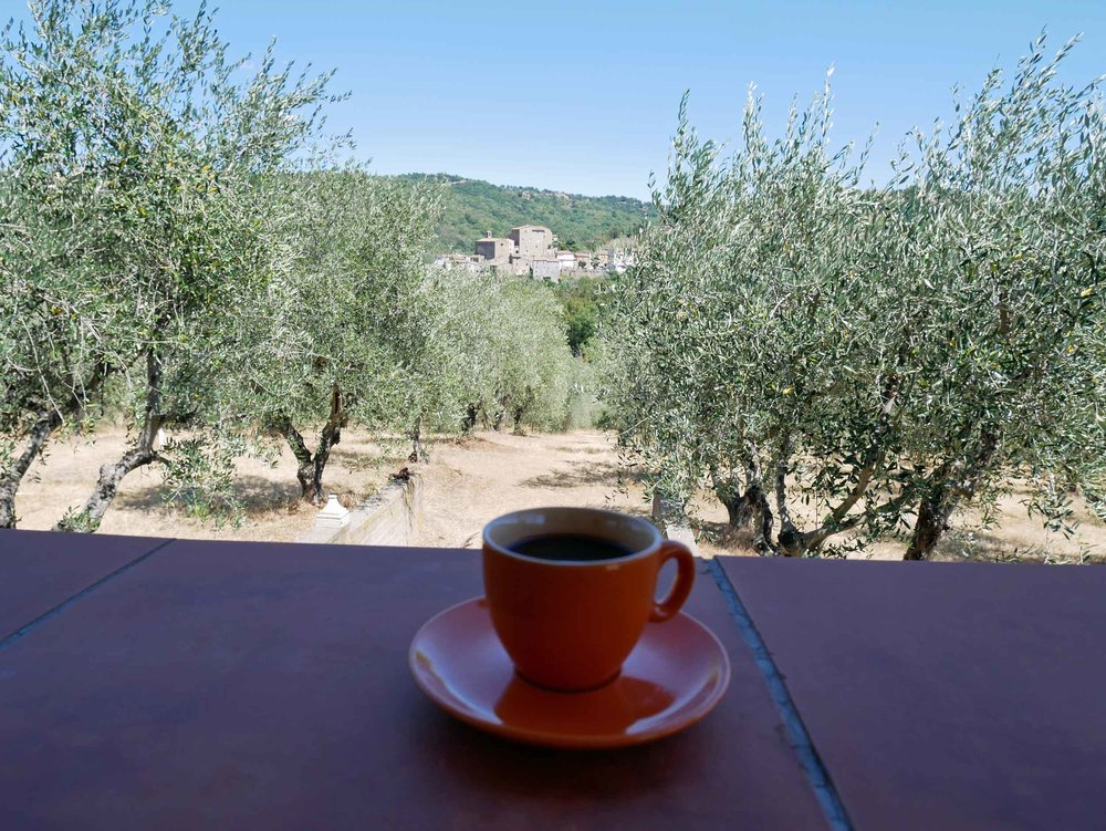 Italian espresso, a shaded terrace, and a charming setting away from it all--heaven!