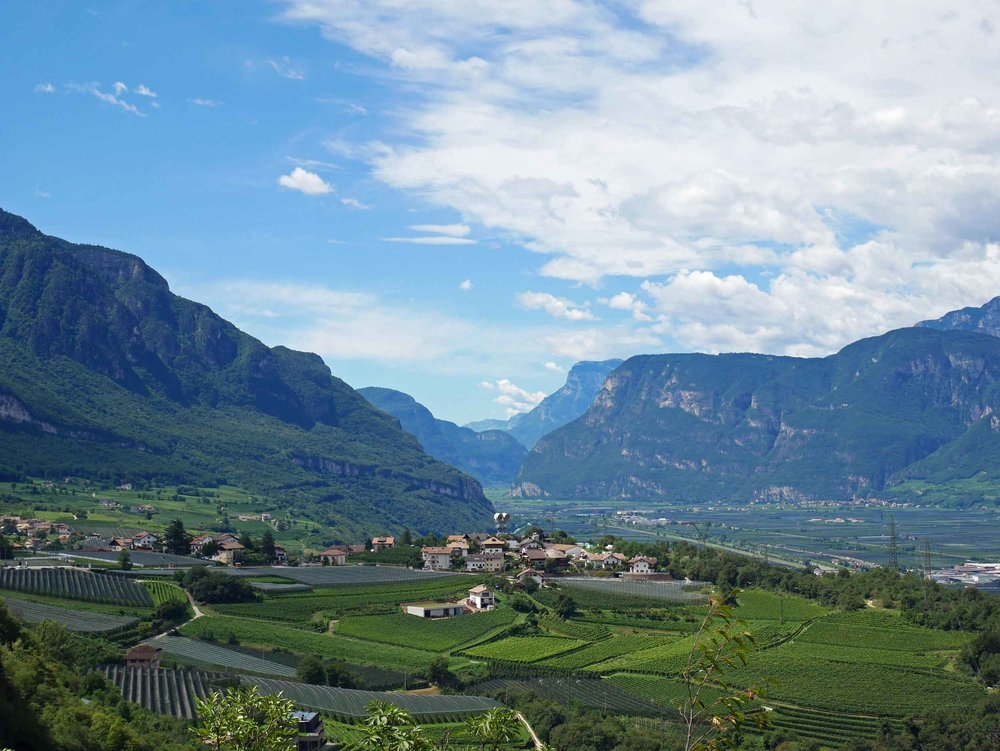 Coming out of the Dolomites toward Lake Garda, a sprawling valley opened before us (July 25).