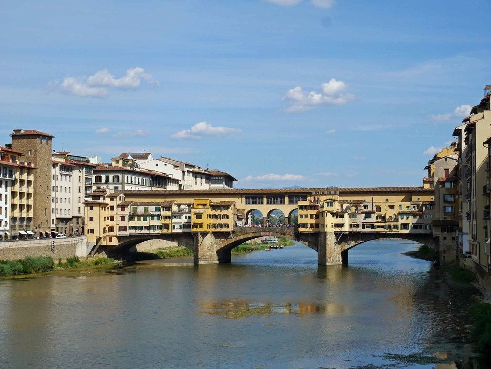 "Florence's famous medieval Ponte Vecchio, or ""Old Bridge"" with shops that dot the arch over the Arno."