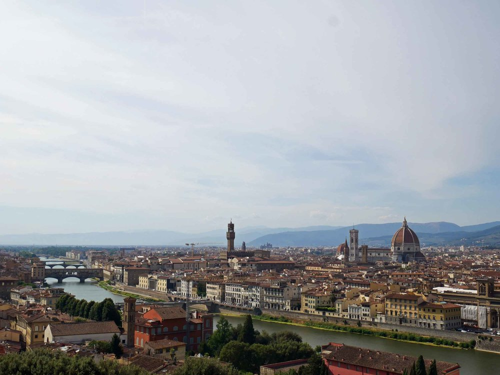 The spectacular view of the Florentine cityscape, including terra-cotta tiled Cathedral dome, from Piazzale Michelangelo.