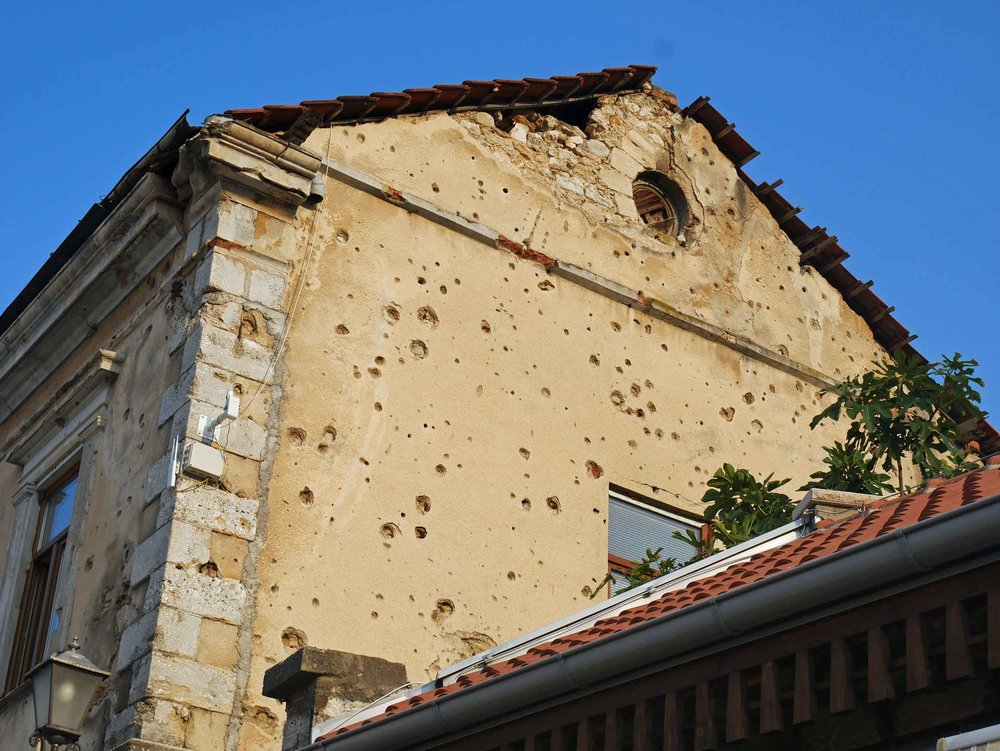 The realities of war were a present reminder throughout ravaged Mostar with marks of bullets on many of the town's buildings.