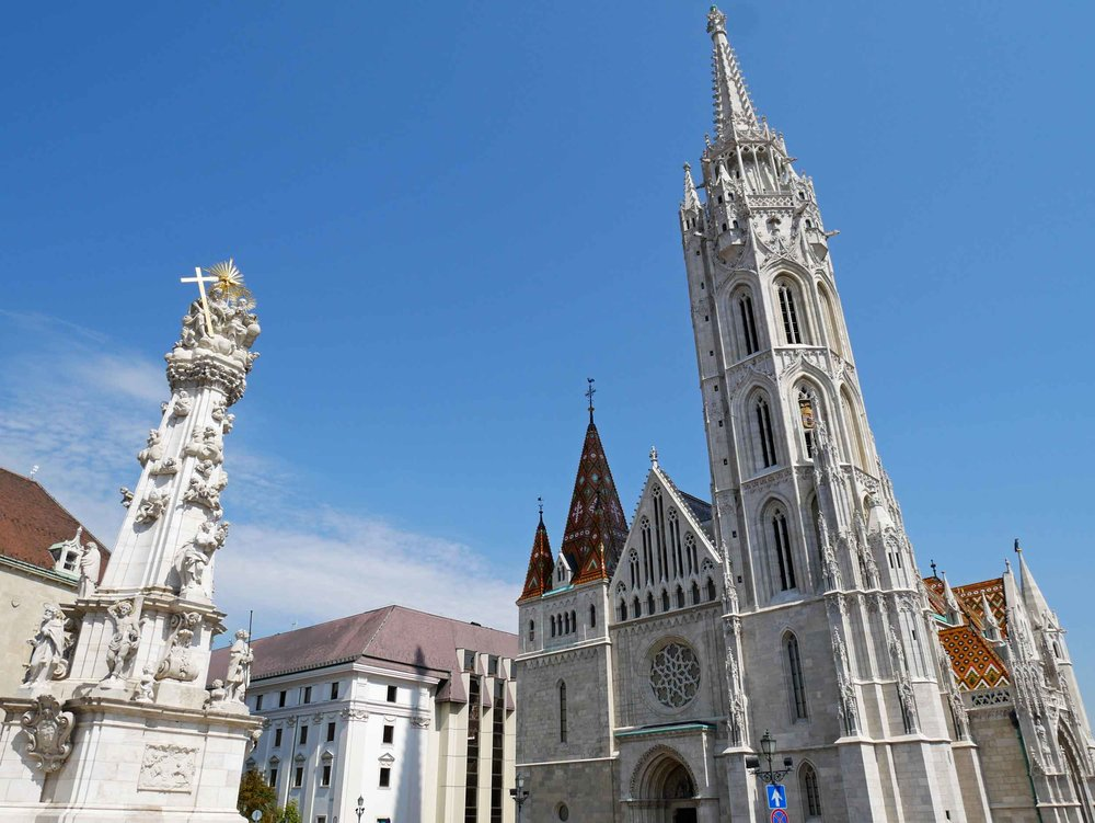 Matthias Church, constructed in the 14th century, stands at the front of Fisherman's Bastion in the Buda Castle district.