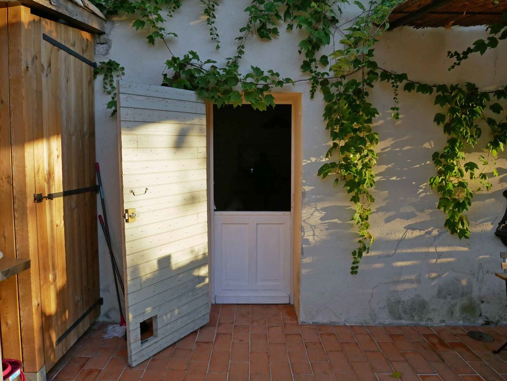 No chateau is complete without an adorable double-hung farm door to allow in the summery French breeze.