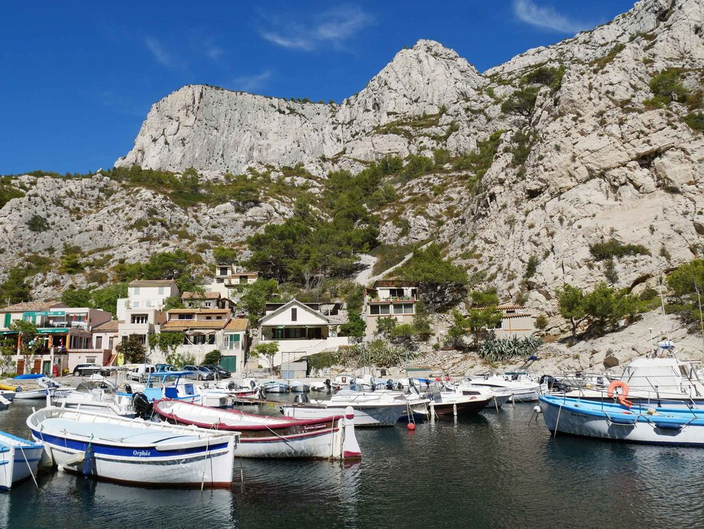 A  calanque  is a steep-sided valley formed within karstic regions either by erosion or the collapse of a cave.