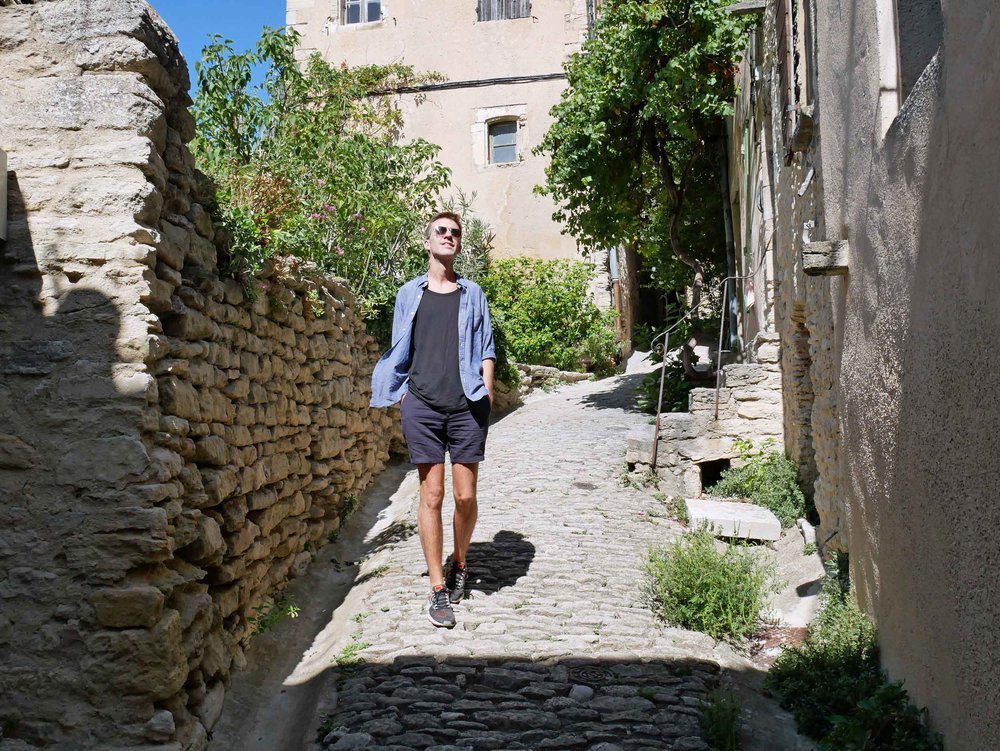 Trey strolling the cobbled streets near the perimeter of the old town's medieval wall.