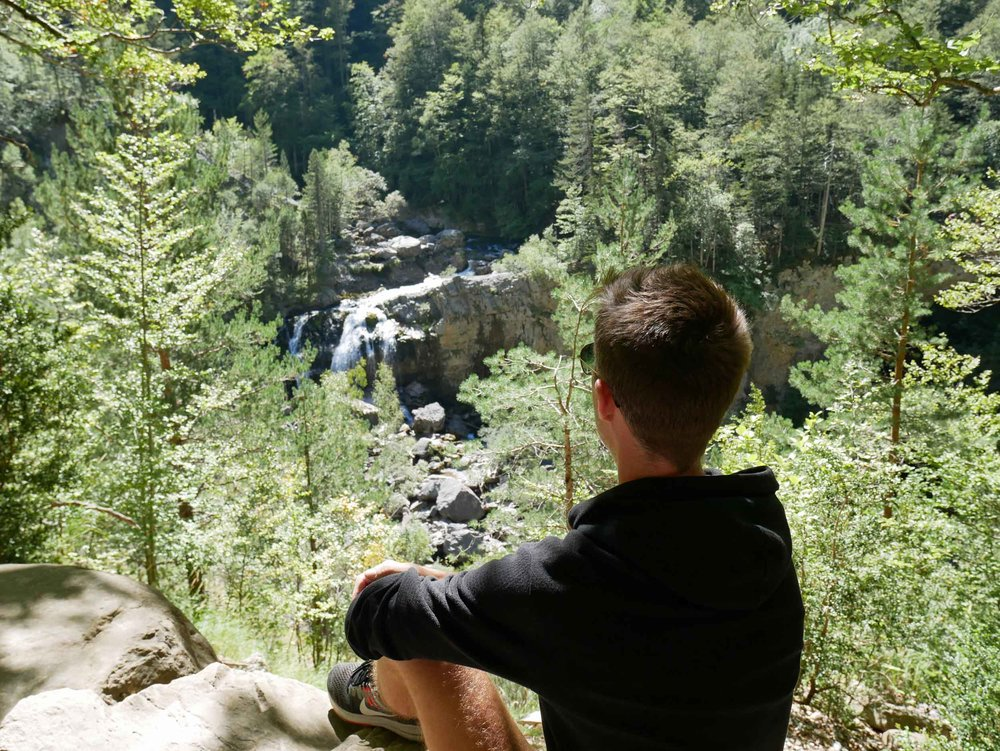 Trey enjoys the view of one of the three waterfalls we discovered during our 'three waterfalls' hike along the Rio Arazas at the base of Ordesa canyon.