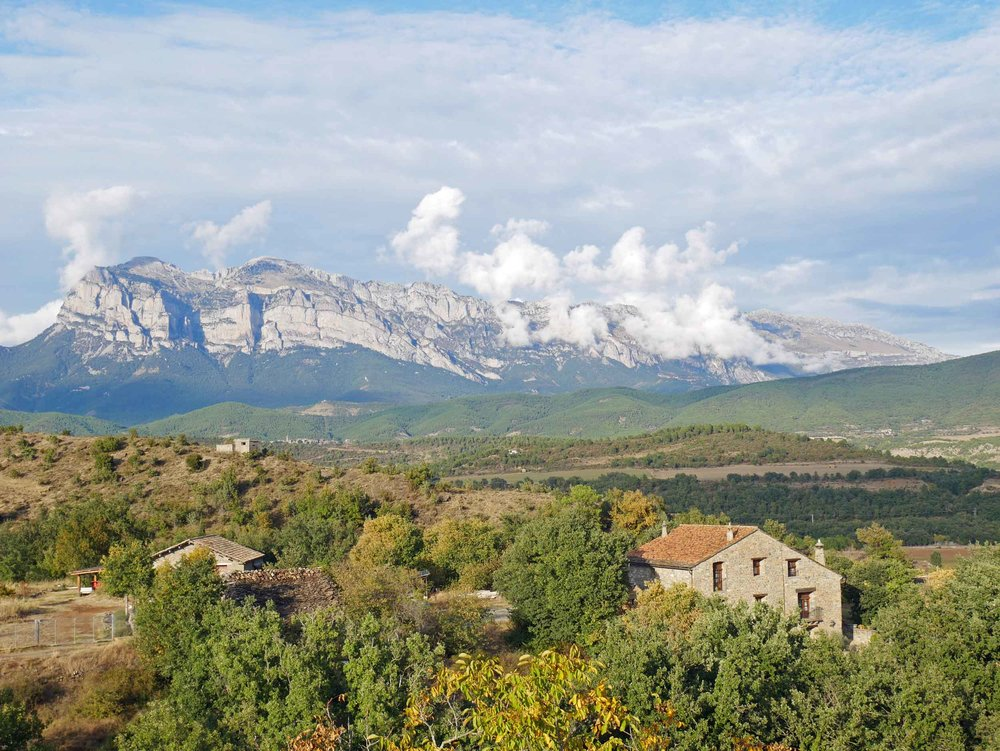 A few kilometres to the north, a great snow-streaked crag (known as the Peña Montañesa) towers high above the village, creating a spectacular backdrop (Sept 22).
