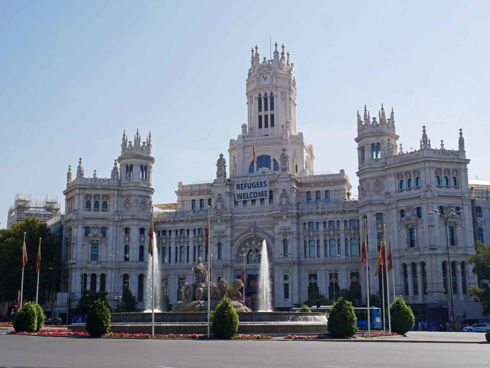 Madrid's magnificent City Hall adorned a welcoming banner for refugees.
