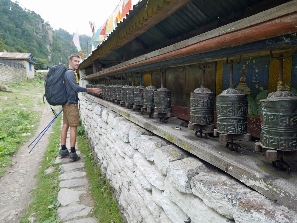 Trey giving the Tibetan Buddhist prayer wheels a spin (his first of many!) on our way out of Tal.