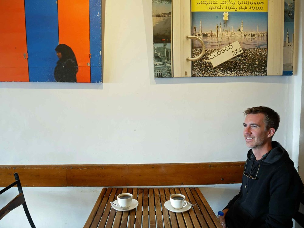 Trey sitting at our favorite coffee shop in McLeod Ganj –  Moonpeak Espresso.