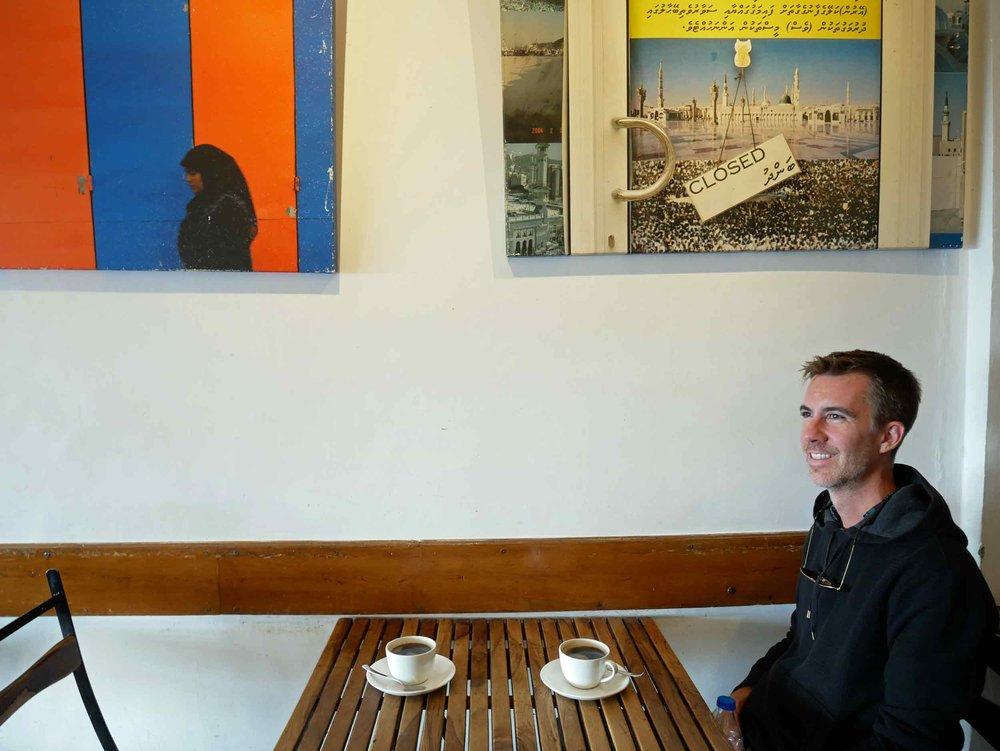 Trey sitting at our favorite coffee shop in McLeod Ganj –  Moonpeak Espresso.