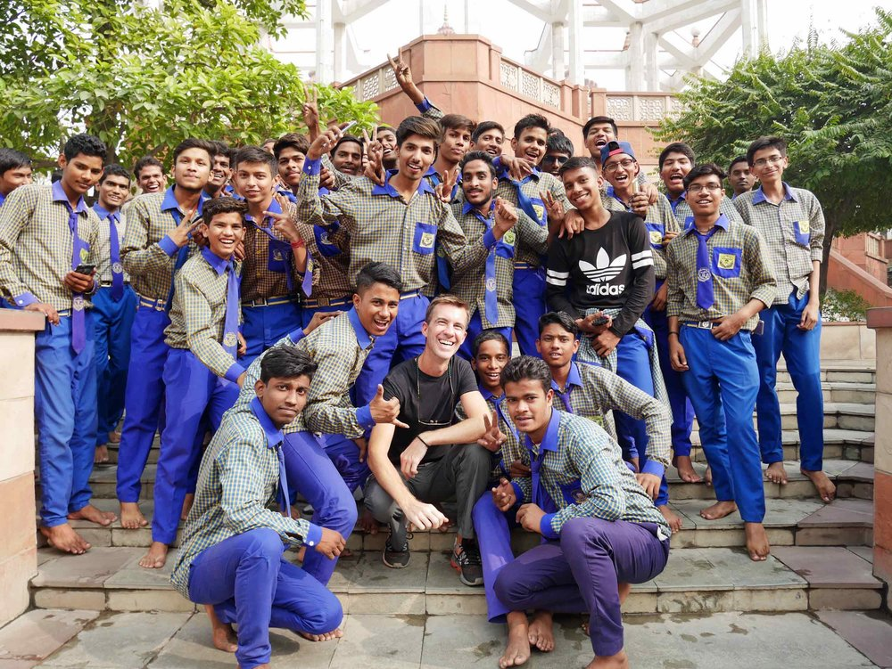 Used to all the picture requests by now, Trey makes friends while visiting Delhi's Hare Krishna Temple.
