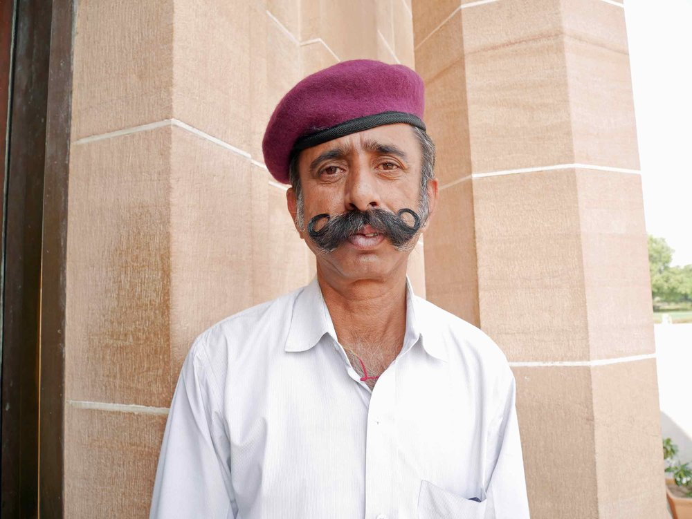 A guard at the Umaid Bhawan Palace in Jodhpur is sporting the facial hair style du jour .