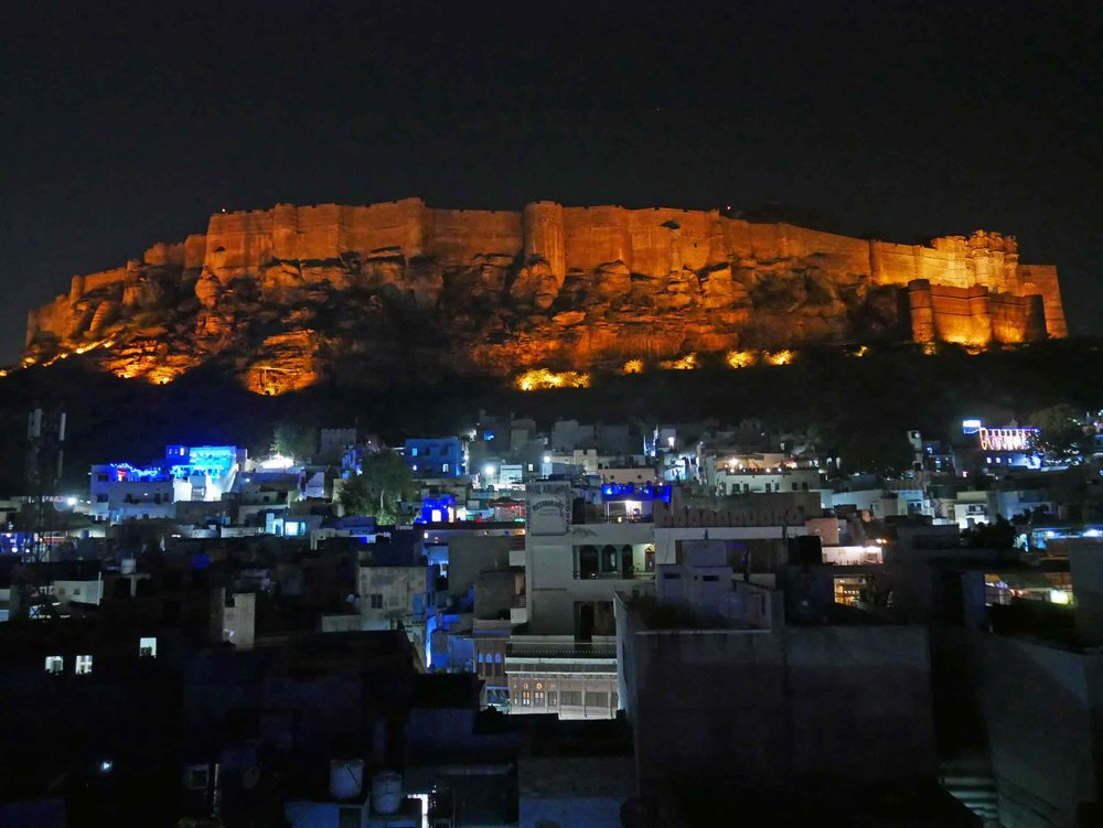 Seemingly carved out of the craggy hillside, the impressive view of Mehrangarh Fort from our guesthouse rooftop was breathtaking (Nov 12).