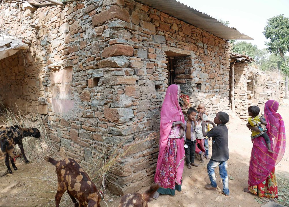 It is very common for tribal villagers to co-habitate with their livestock in order to protect them from the area's wild leopards.