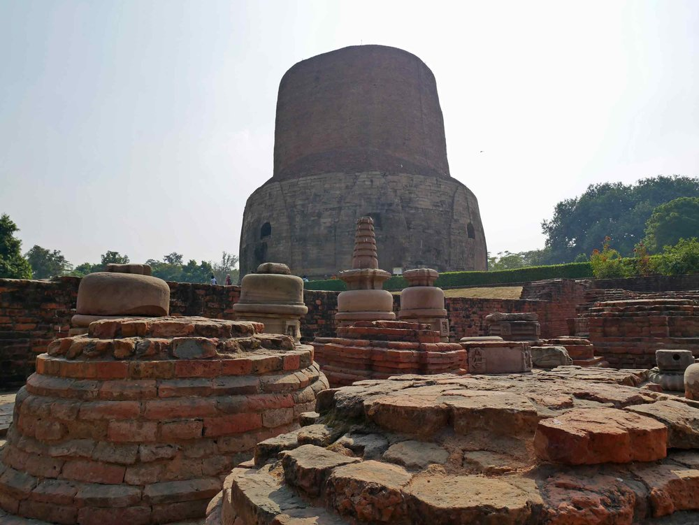 Dhamek Stupa in Sarnath marks the spot where the Buddha delivered his first teaching.