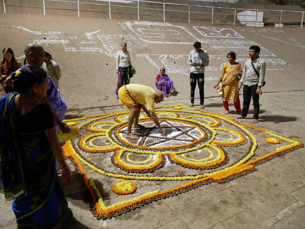 A giant mandala was being created and offered on the  ghats .