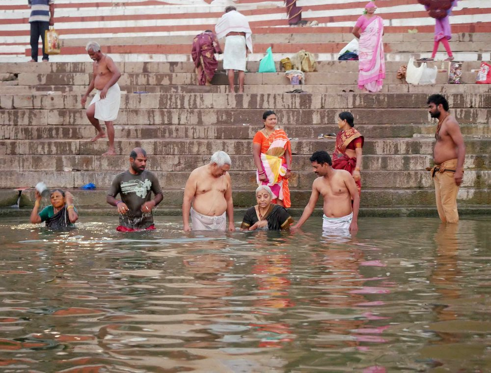 On our final day in Varanasi, we took a sunrise boat trip and witnessed the Ganga come to life.  Here, Hindu worshipers bathing in the river to wash away all sins (Nov 18).