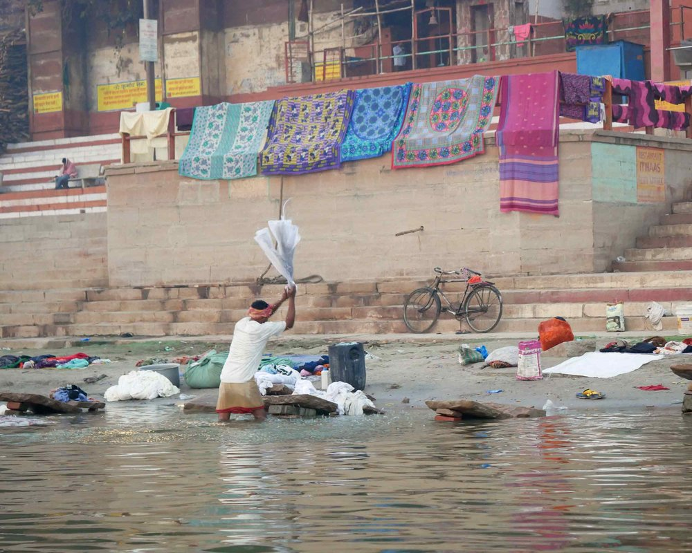 It's not all holy worship and ritual at the river – here, clothing is being washed in earnest.