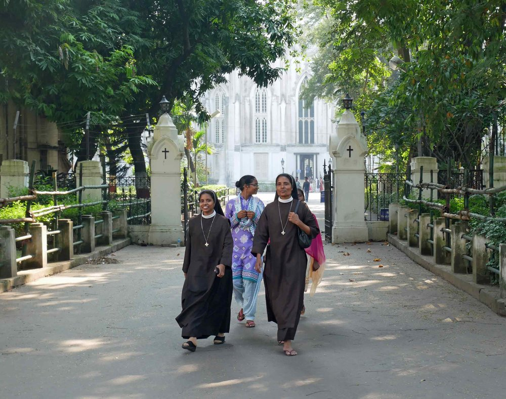 Nuns exiting the grounds of St. Paul's in Kolkata.