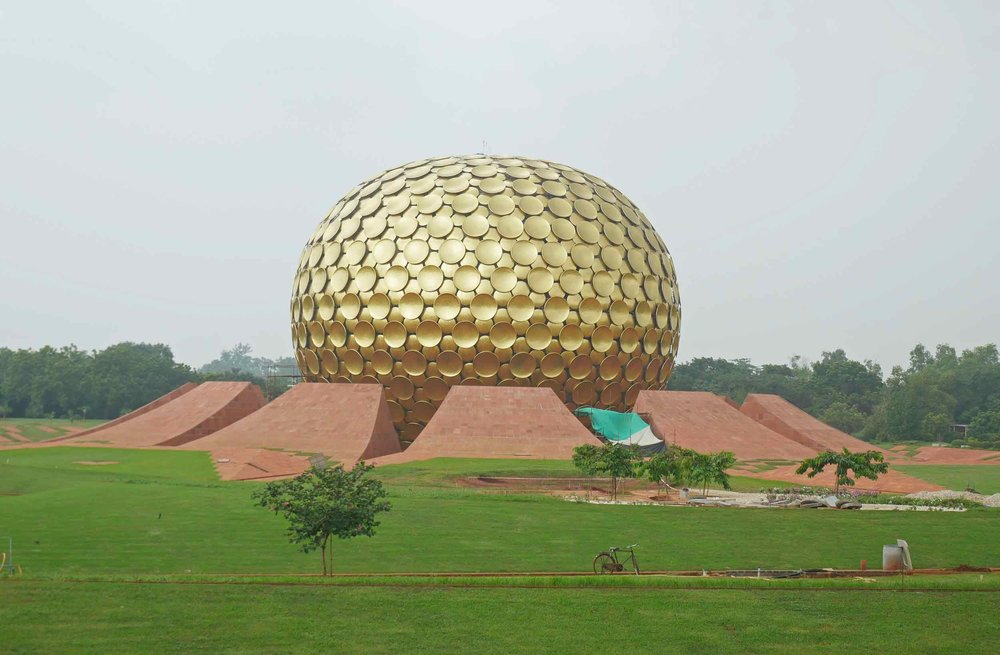 The centerpiece of Auroville, the Matrimandir, or Mother's Temple, designed in the likeness of the lotus flower (Nov 24).