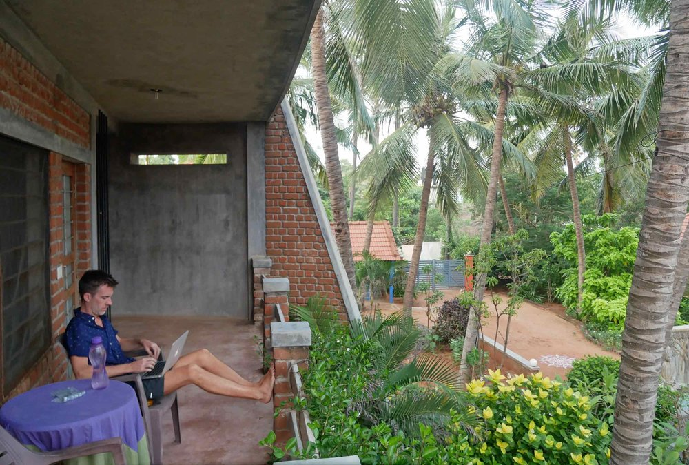 Trey took full advantage of the cool breezes and views of the Bay of Bengal to be had from our studio balcony.