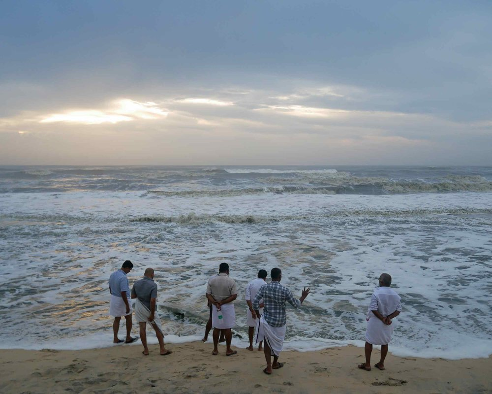 A group of Keralan men took in the last rays of light as we said goodbye to India (Dec 3).