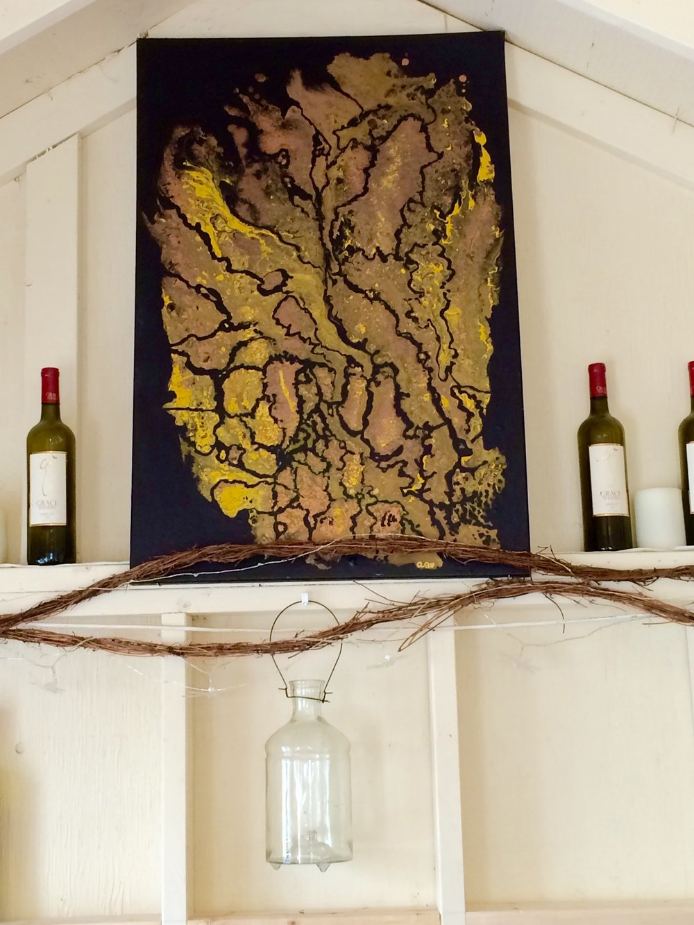 """""""Rush"""" hung in Grace Winery's tasting room."""