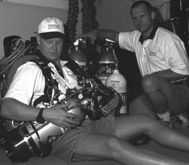 Bill Nadeau and David Sawatzky preparing equipment prior to an underwater cave survey expedition on the north end of Vancouver Island.
