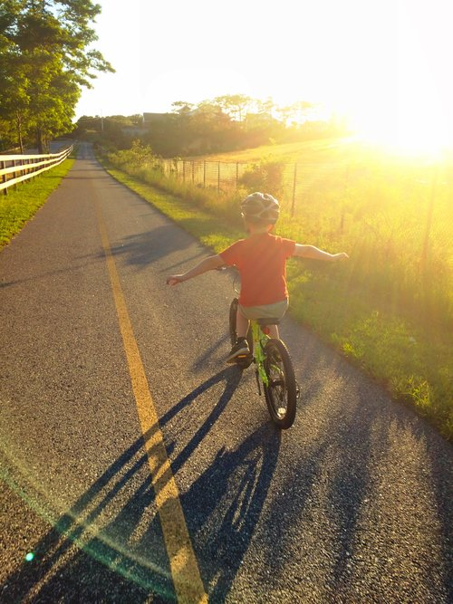 Jakob flying on the Cape Cod Rail Trail