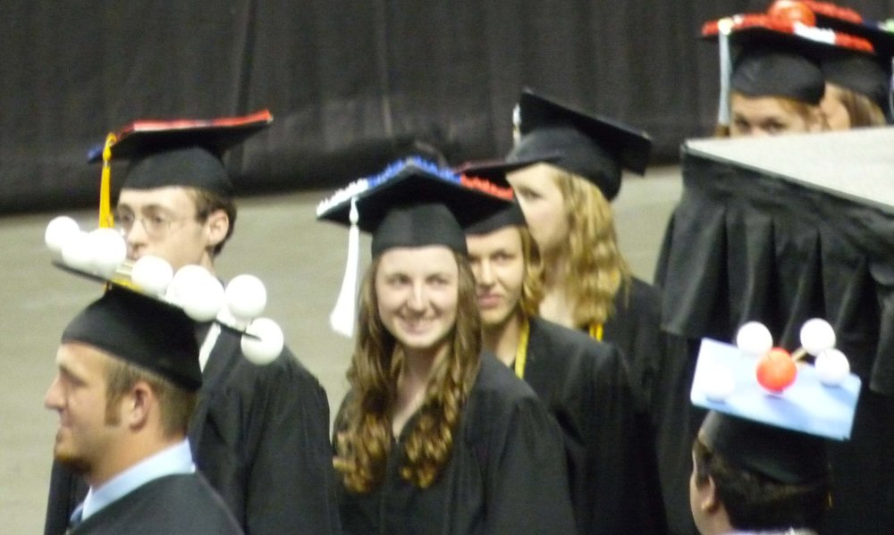 Whitworth grads decorate their mortarboards