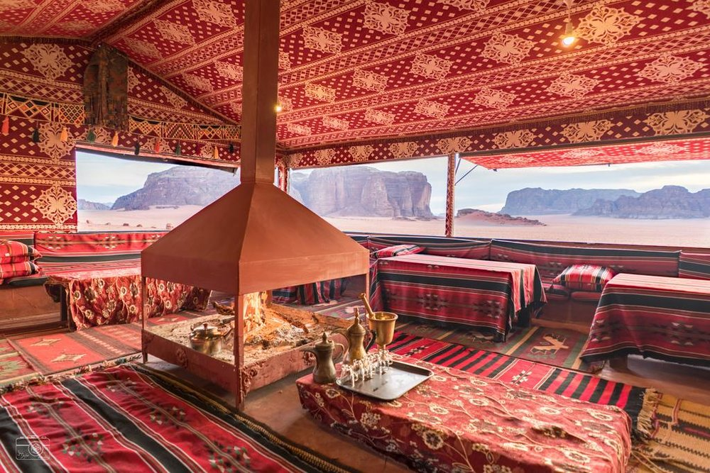 Bedouin Camp - Our camp is situated inside Wadi Rum's Protected Area, only 6 km from the Wadi Rum Village and surrounded by magnificent sandstone formations. This is the land where Lawrence Arabia once fought with Bedouins, against the Ottoman Empire. You can walk around and let your imagination run free, or simply find yourselves the perfect panorama view.OUR TENTSOur high quality, goat-hair tents provide you with a comfortable night in our desert. The tents are raised and private and can accommodate many different sized groups. Each tent is equipped with its own indoor light so you can move around easily at all times of day.