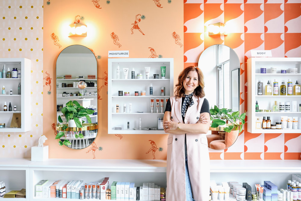 Laura at her natural beauty and wellness shop, Lemon Laine. Emily Dorio