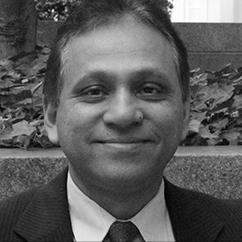 "<span style=""font-weight:bold"">Dilip Ratha</span></br><em>Head of KNOMAD and Lead Economist</em></br>World Bank"