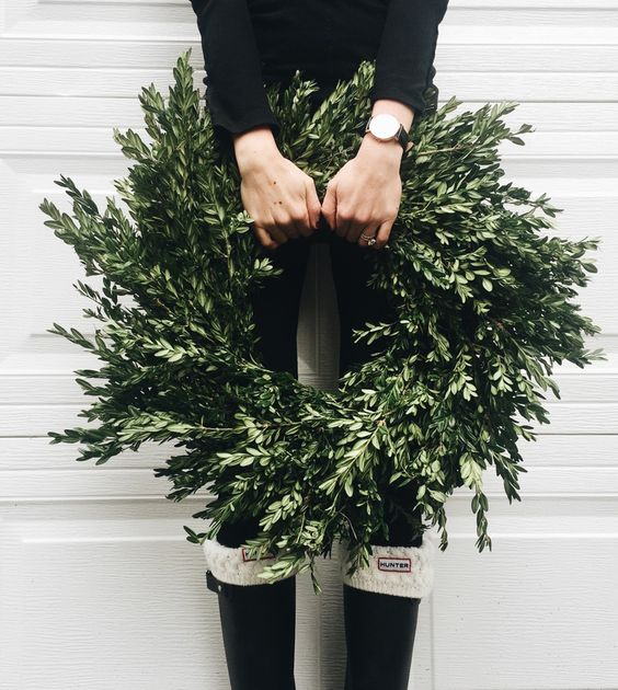 Jules and Louis Blog | festive wreaths - girl holding wreath with boots