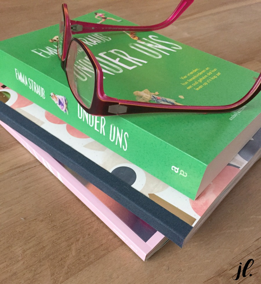 Jules and Louis Blog | close up book The Lovers by Emma Straub - glasses on stack of books