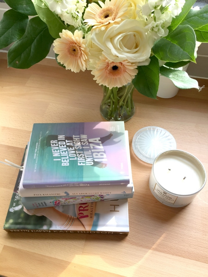 Jules and Louis Blog - Unwinding With Books - flowers and stack of books
