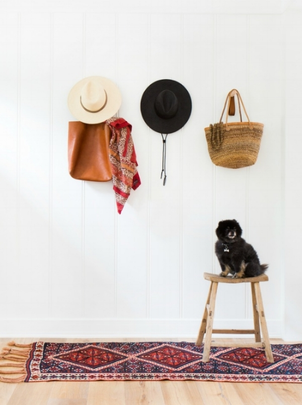 jules-and-louis-blog-home-tour-amber-interiors-hall-chair-with-dog-and-hats.jpg