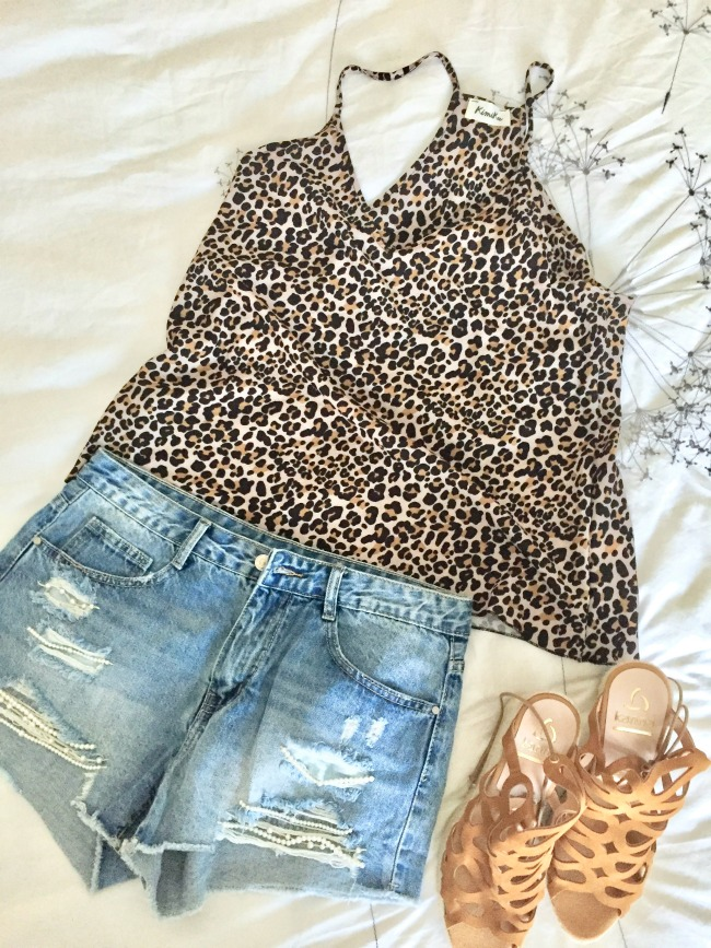 Jules and Louis Blog - How to pack for vacation - lay out outfits.jpg