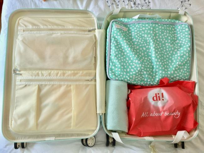 Jules and Louis Blog - How to pack for vacation - inside my suitcase Suit Suit.jpg
