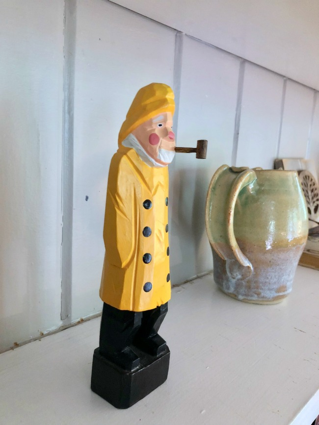 Jules and Louis Blog - A cute adorable home in Tallahassee - detail of wooden figurine in library.jpg