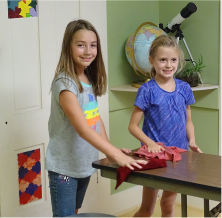 Teagan and Piper worked together on some cleaning tasks during the Fall Fresh Start Chore Hunt last week.