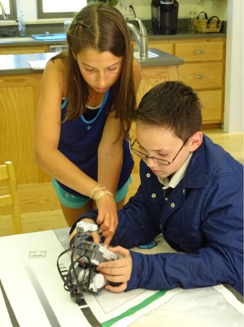 Jasmine and Caleb tested out an early version of a Lego robot in their elective last week.