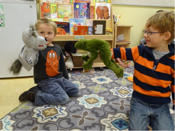 Clayton and Wyatt played with puppets in the Preschool classroom today.