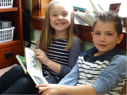Logan and Marlie enjoy reading together in Mrs. Toney's class.