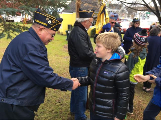 4th grader Nick Heinrich thanked one of the Veterans for his service at the observance in Lyndonville on Friday.