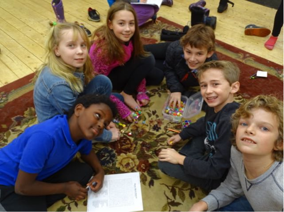 Yofta, Cliona, Teagan, Cameron, CJ, and Donovan played games on the floor of the yurt last week.