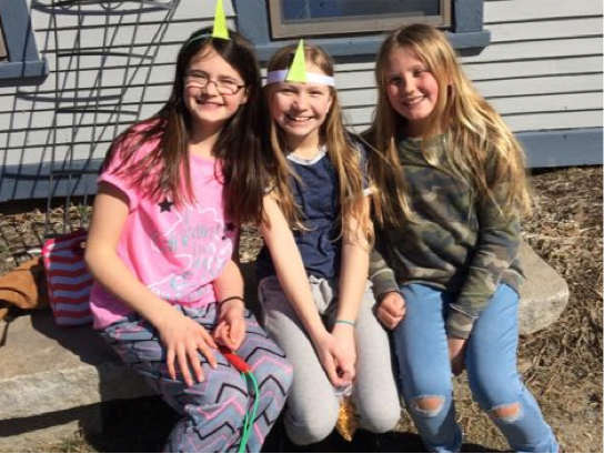 Alexa, Ruby, and Josie soaked up the sun, with unicorn crowns, during break this morning.