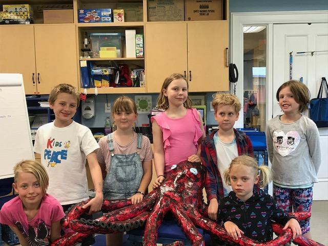 The third grade is proud of their scale model of an octopus, an artistic aspect of their integrated ocean unit this spring.